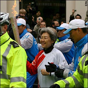 Fu Ying carries the Olympic torch through London.