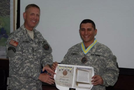 U. S. Army Col. Alfred Dochnal presented U.S. Army Sgt. 1st Class Fidel Cisneros convoy security platoon sergeant the prestigious Order of Saint Maurice infantry medallion of the Centurion level, for outstanding contributions to the infantry.