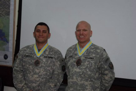 U.S. Army Sgt. 1st Class Tim Leckie and U.S. Army Sgt. 1st Class Fidel Cisneros, convoy security platoon sergeants, after receiving the prestigious Order of Saint Maurice infantry medallion of the Centurion level.