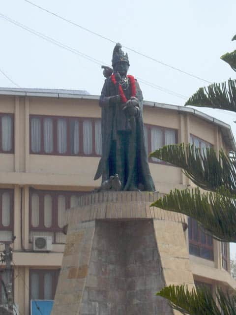 Across from the polling station in Jawalakhel, royalist supporters put a fresh flower garland on the statue of King Birendra, assassinated in 2001.