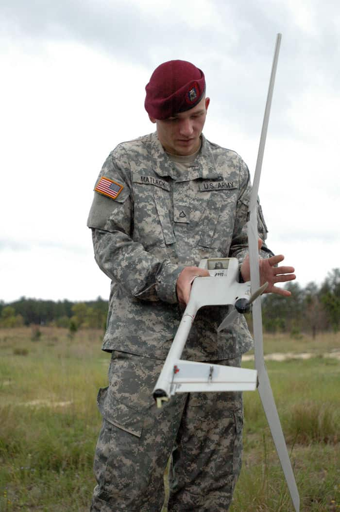 infantryman Pfc. Kyle J. Matlack assembles the Raven unmanned vehicle.