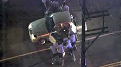 Philadelphia a half dozen officers held two men on the ground, kicking them repeatedly, while one was punched; one also appeared to be struck with a baton.