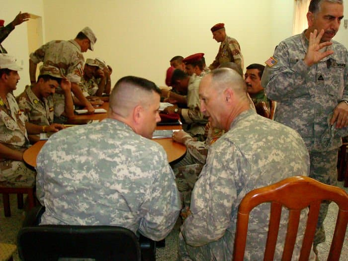 Sgt. Maj. Terry Grezlik and Command Sgt. Maj. John Gioia share a couple of quick observations as the senior enlisted leaders in the 6th Iraqi Army Division gather.