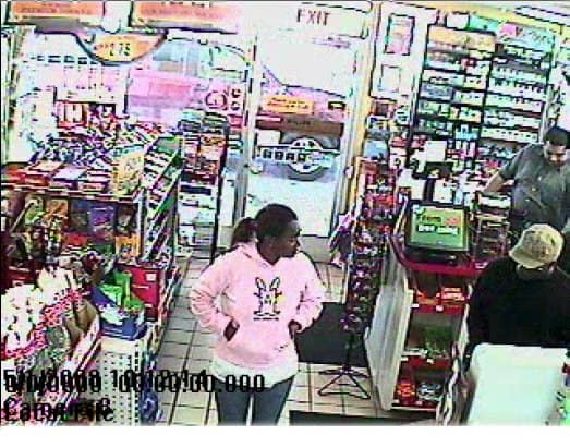 Black female suspect in pink top.