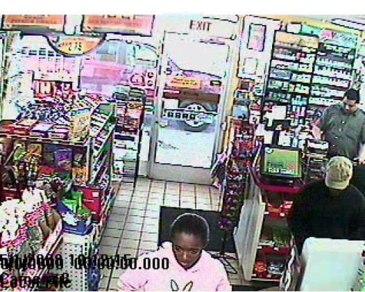 African American woman suspect with hair tied back.