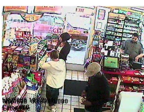 Black man wearing tan cap is a person of interest.