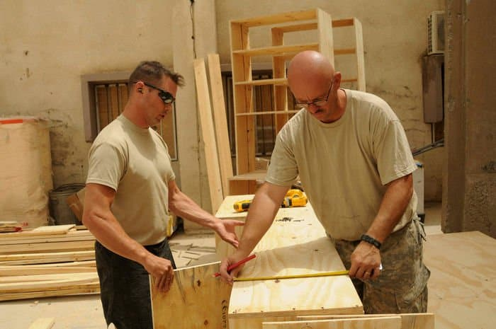 Sgt. First Class Jeremy Frank, a construction supervisor, and Sgt. Bob Crandall, a carpentrymasonry specialist, perform vital construction at Joint Security Station Sadr City.
