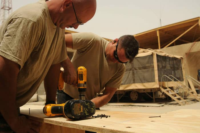 Sgt. 1st Class Jeremy Frank, a construction supervisor, and Sgt. Bob Crandall, a carpentrymasonry specialist perform vital construction in Sadr City.