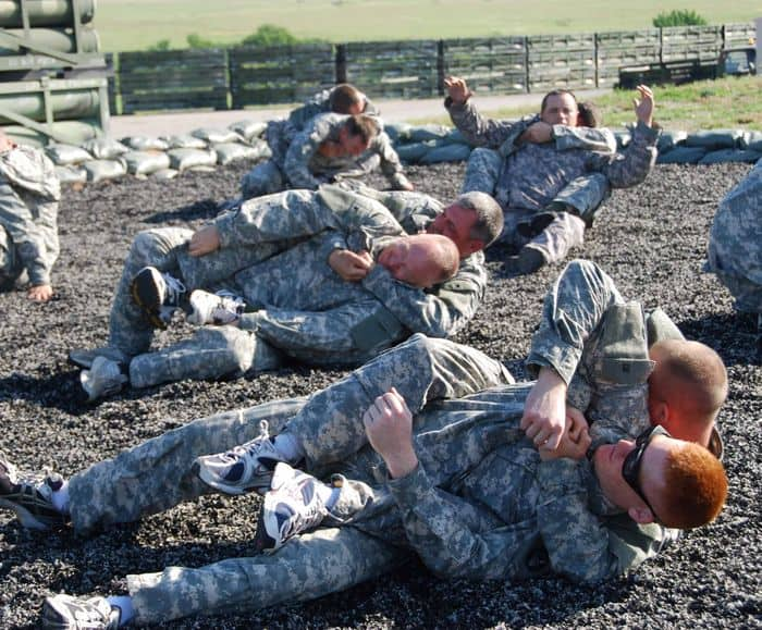 Soldiers practice hands on combative techniques