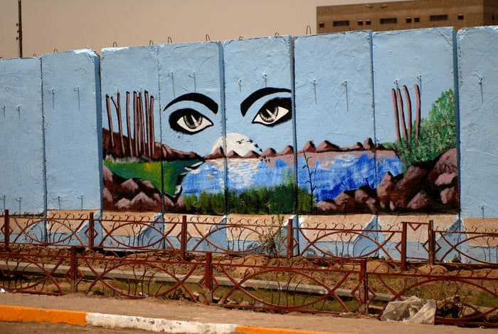 One of more than 50 murals on protective barriers in the Sadr City district of Baghdad