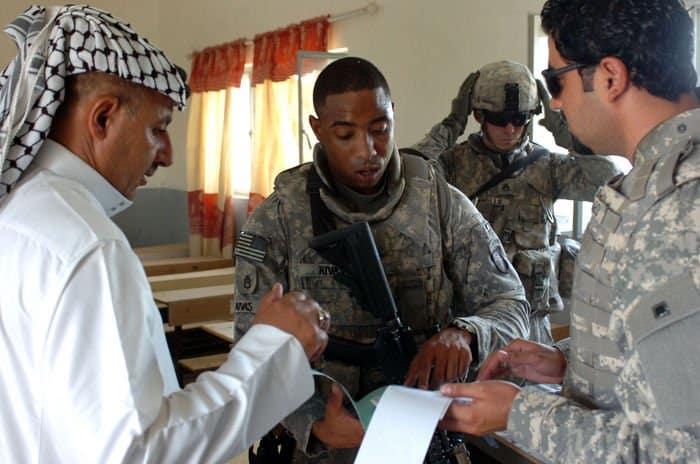 Staff Sgt. Michael Rivas talks with a local man in Radwaniyah.