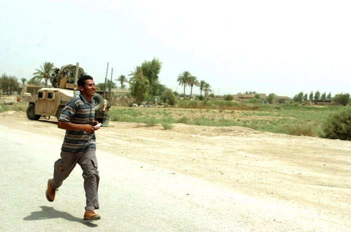 A Sons of Iraq member runs in full stride during a 1,500 meter run in Radwaniyah.