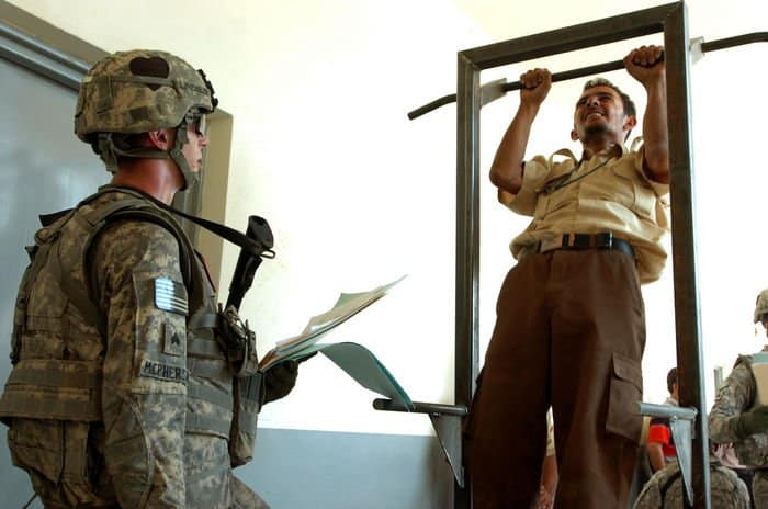 A Sons of Iraq, or Abnaa al Iraq, member completes a set of pull ups in a physical fitness test in Radwaniyah.