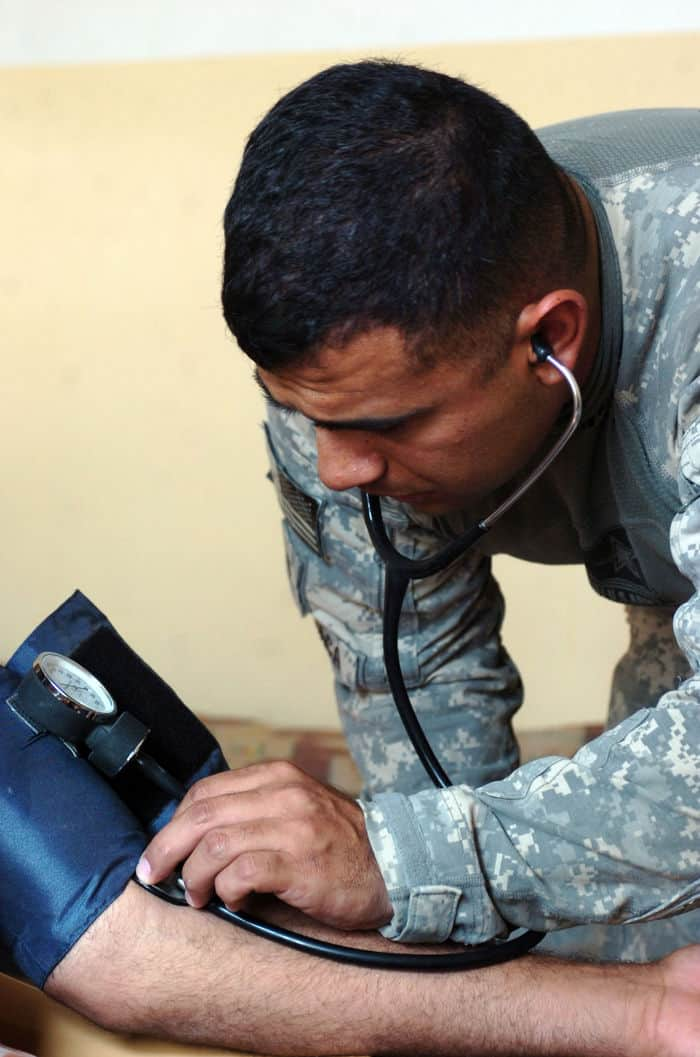 Spc. Leonard Estracachecks a Sons of Iraq blood pressure during a medical screening in Radwaniyah.