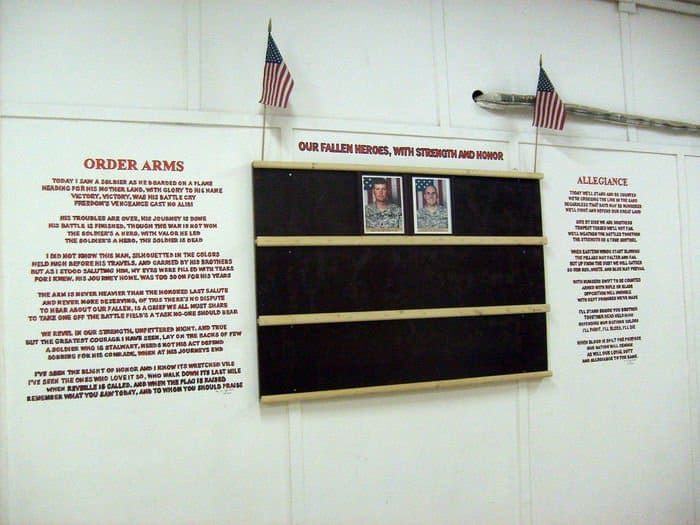 Two poems written by Spc. Flint Christensen, with photos oftwo fallen Soldiers on a 10th Mountain Division hero wall.