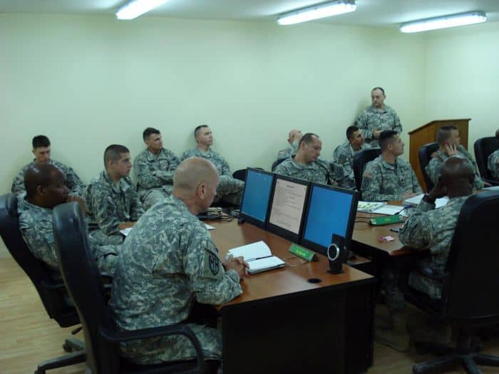 Soldiers of the 18th and 8th Military Police Brigades discuss Police Transition Team operations.