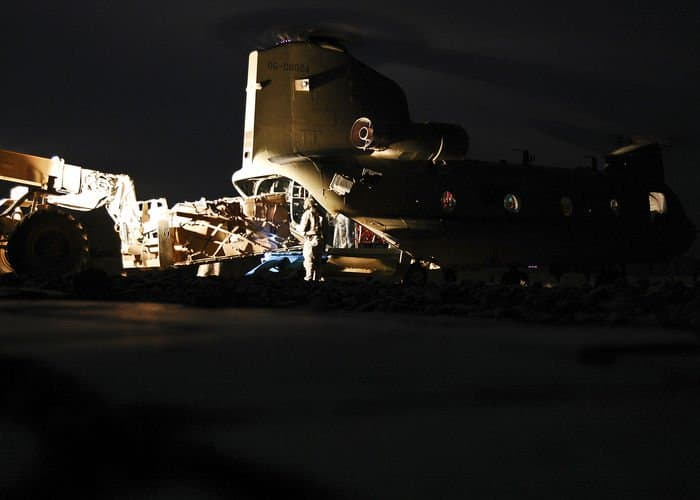 Crew Soldiers load cargo into the back of a CH 47F Chinook Improved Cargo helicopter