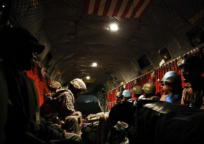 Passengers take their seats on a CH 47F Chinook at the U.S. Coalition controlled section of the Baghdad International Airport