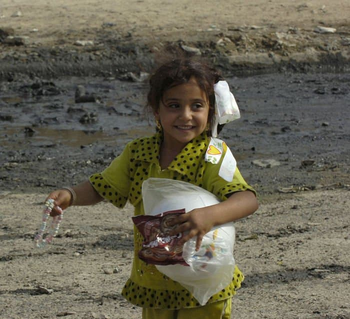 An Iraqi child heads home with gifts from 1Bn 6th Infantry 3BCT 1st Armored Div. soldiers.