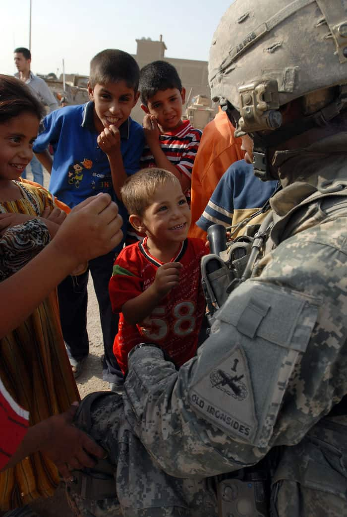 Iraqi children happily greet infantryman Spc. Chris Jackson.