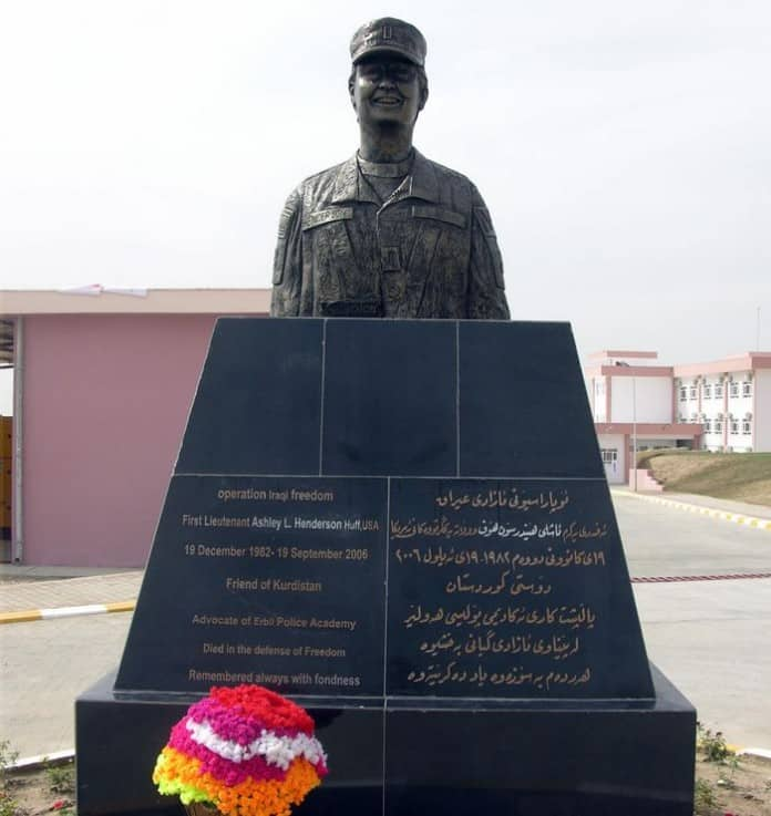 A bronze bust of U.S. Army 1st Lt. Ashley Henderson Huff being unveiled in a hand over ceremony of the Erbil Police Academy.