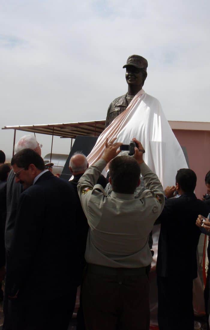 A bronze bust of U.S. Army 1st Lt. Ashley HendersonHuff being unveiled during a ceremony at the U.S. Army Corps of Engineer's project hand over ceremony of the Erbil Police Academy. Henderson Huff was a military police officer assigned to a U.S. Army Military Police Transition Team in 2005. She died of injuries suffered in Mosul, Iraq, Sept. 19, 2006, when a suicide vehicle borne improvised explosive device detonated near her mounted patrol during combat operations. (U.S. Army photo by Lt. Col. Randal Mock)