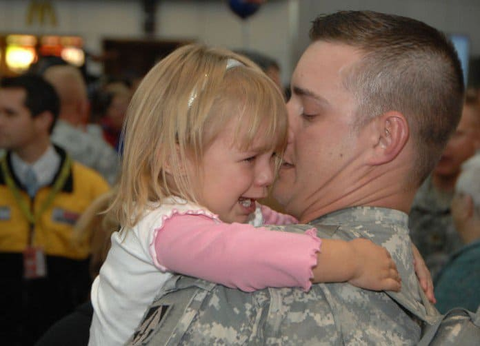 Payton Smoot, 4, clutches her father, 2nd Lt. Robert Smoot of Indiana 76th Infantry BCT, who just returned from Iraq at Indianapolis International Airport.