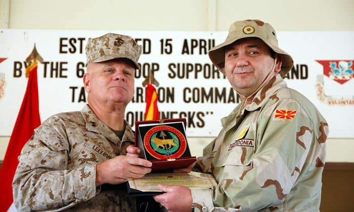 Marine Maj. Gen. Paul Lefebvre, deputy commanding general, MNC Iraq, presents the MNC I medallion to Macedonian Maj. Gen. Zoran Dimov, commander of Joint Operations Command, Macedonian Army, at an end of mission ceremony.