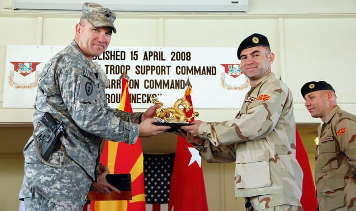 Lt. Col. Thomas Boccardi, commander, 1st Battalion, 14th Infantry Regiment Golden Dragons, 2nd Stryker BCT, 25th ID, MND B, presents a golden dragon to Macedonian Capt. Stevan Blagoja Naumoski, Ranger platoon leader, Macedonian Rangers