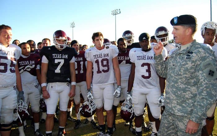 Col. David Thompson with Mike Sherman, the Aggies head coach, who spoke with his players about the significance of wearing the Ironhorse Division patch.