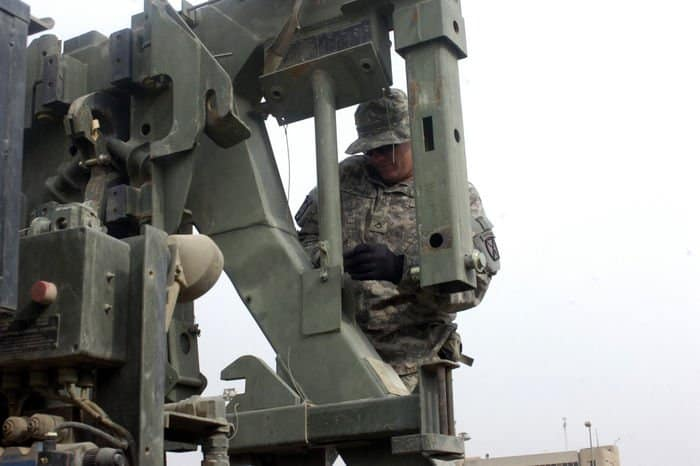Pfc. Derrick Durham conducts a pre combat check on his truck at FOB Loyalty.