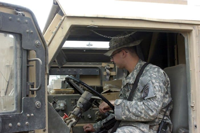 Sgt. Michael George starts a pre combat vehicle inspection.