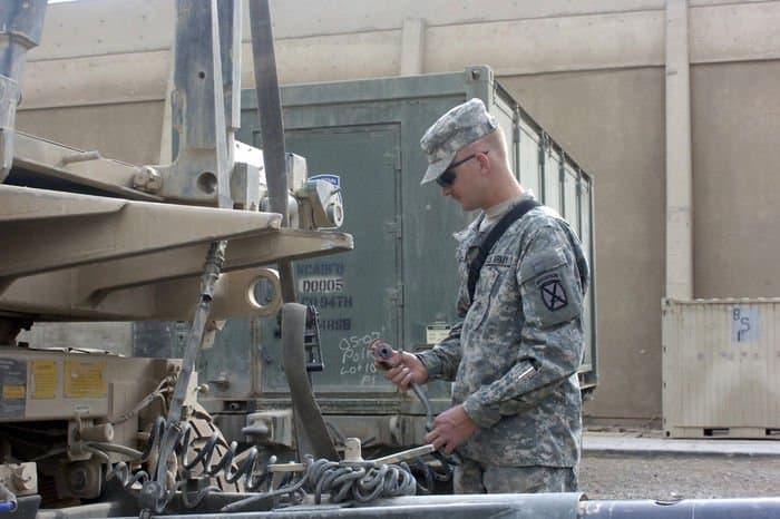 Spc. Ryan Pengelly starts a pre combat equipment inspection.