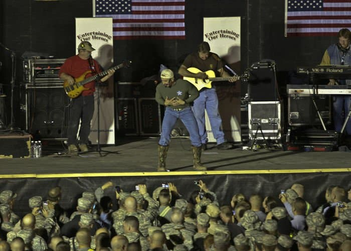 Country music singer Aaron Tippin sings with MND B Soldiers, Sailors, Airmen, Marines and civilians.