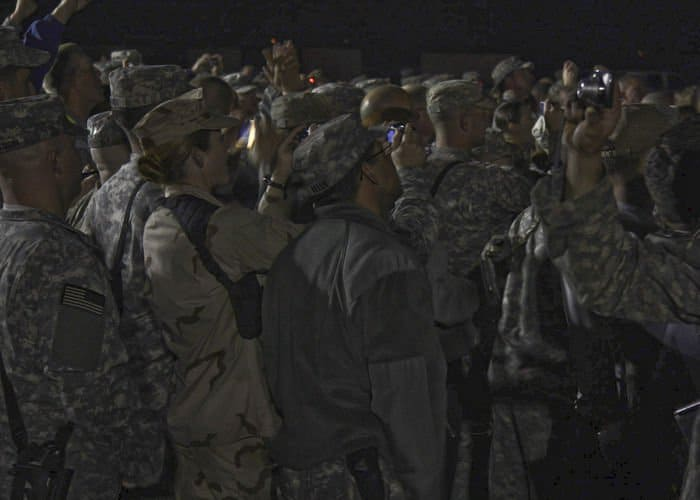 MND B Soldiers, and other Soldiers, Sailors, Airmen, Marines and civilians gather together in front of 4ID headquarters