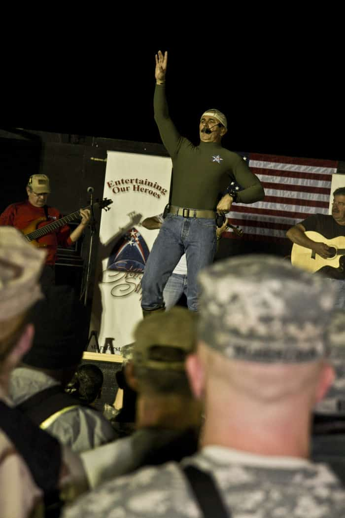 Country music singer Aaron Tippin entertains MND B Soldiers, along with other Soldiers, Sailors, Airmen, Marines and civilians in front of 4ID