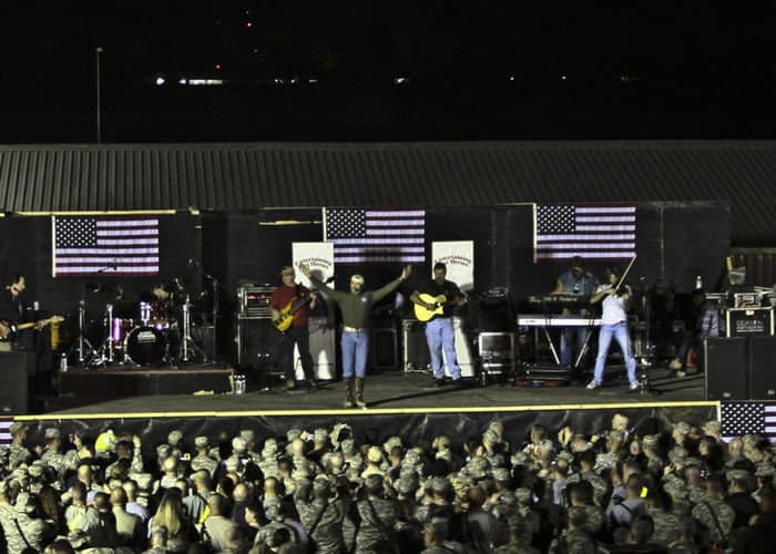 Soldiers, Sailors, Airmen and Marines, rock with Aaron Tippin at a Thanksgiving Day concert.