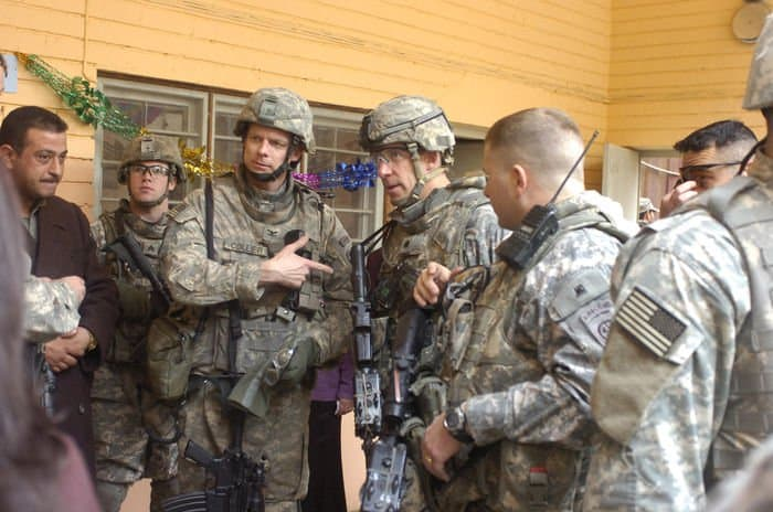 Col. Craig Collier, commander of the 3rd Squadron, 89th Cavalry Regiment, 4BCT, 10th Mountain Division, introduces Lt. Col. Dave Buckingham, commander of 5th Squadron, 73rd Cavalry Regiment, 3BCT, 82nd Airborne Division, to local district and school officials after the Motasum Elementary School renovation ceremony in eastern Baghdad.