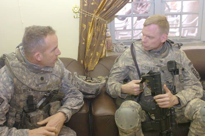 Lt. Col. Dave Buckingham, commander of 5th Squadron, 73rd Cavalry Regiment, 3BCT, 82nd Airborne Division, MND B, speaks with Col. Craig Collier, commander of the 3rd Squadron, 89th Cavalry Regiment, 4BCT, 10th Mountain Division, after the renovation ceremony of the Motasum Elementary School in eastern Baghdad.