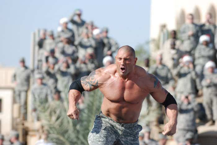 WWE superstar Dave Batista steps in the ring for his wrestling match during the WWE Tribute to the Troops