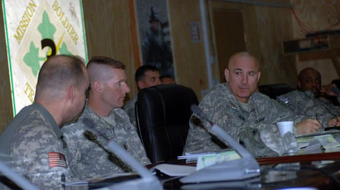 Command Sgt. Maj. Dennis Carey, the senior enlisted leader of U.S. Army Forces Command, listens as Command Sgt. Maj. John Kurak, 1st Battalion, 68th Armor Regiment, 3BCT, 4ID, briefs him on the capabilities of the Iraqi National Police