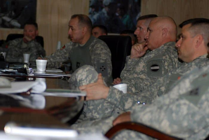 Command Sgt. Maj. John Kurak briefs Command Sgt. Maj. Daniel Dailey, 3BCT, 4ID; Command Sgt. Maj. Dennis Carey, U.S. Army Forces Command; and Command Sgt. Maj. John Gioia, MND B and 4ID.