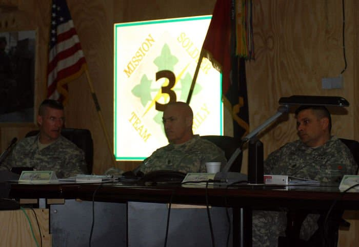 Command Sgt. Maj. Daniel Dailey, 3BCT, 4ID senior enlisted leader, briefs Command Sgt. Maj. Dennis Carey, U.S. Army Forces Command, on brigade operations as Command Sgt. Maj. John Gioia, MND B and 4ID listens.