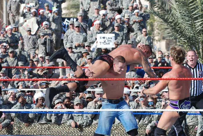WWE Inc. superstar John Cena slams Randy Orton during the WWE Tribute to the Troops
