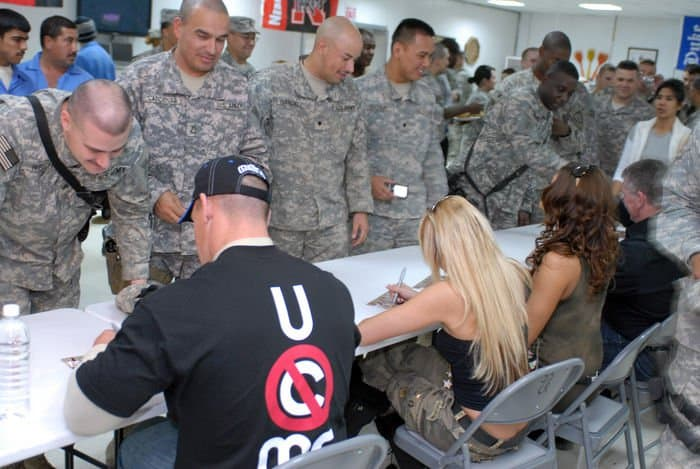Soldiers from 3BCT, 4ID, MND B, line up for autographs and pictures with World Wrestling Entertainment Superstars at FOB War Eagle