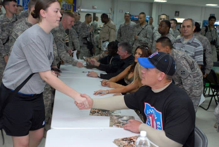 Sgt. Kourtney Wright, from Keokuk, Iowa, shakes hands with World Wrestling Entertainment Superstar John Cena at FOB War Eagle