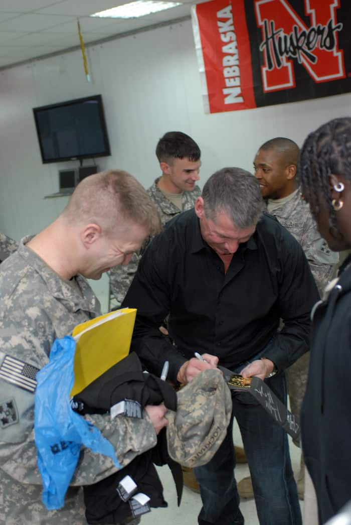 World Wrestling Entertainment Chairman Vince McMahon signs a title belt for Maj. Shawn Lockhart, a Roanoke, Va., native, at FOB War Eagle