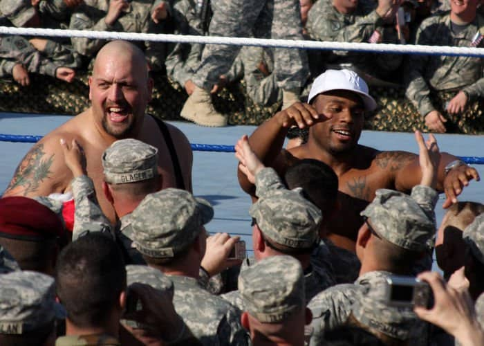 WWE wrestlers The Big Show and Cryme Tyme Shad greet Soldiers after the show on the Tribute to the Troops Tour in front of Al Faw Palace.