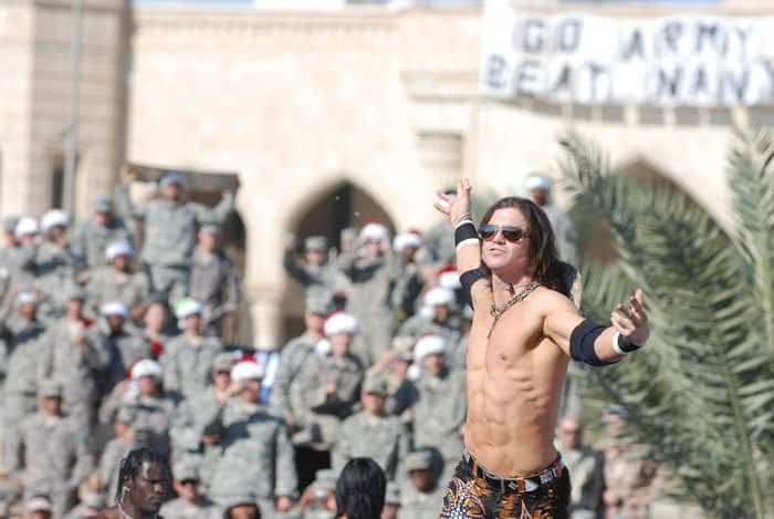 WWE superstar John Morrison steps in the ring for his wrestling match during the WWE Tribute to the Troops.