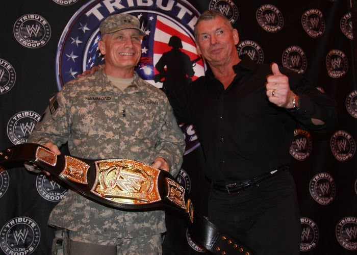 Maj. Gen. Jeffery Hammond, a Hattisburg, Miss. native, commanding general, MND B, poses with Vince McMahon, World Wrestling Entertainment chairman, before the WWE wrestlers took the ring during the Tribute to the Troops Tour in front of Al Faw Palace.